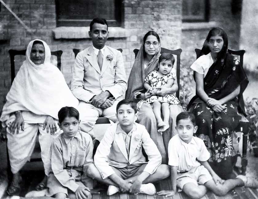 Seated 1st row (L to R) - Nani (Dr Saraswati's mother), Sri Jetha Nand, Dr Saraswati Nand with Surinder , Santosh. 2nd row (L to R) - Anand, Amrit (Dr Sita's late husband) and Prem Prakash